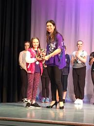 Eleanor winning the Character solo trophy, being presented to her by the adjudicator xxx